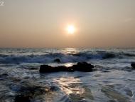 Západ slunce u moře. Arambol, Goa, Indie