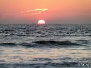 Západ slunce na pláži. Varkala, Kerala, Indie